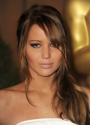 Jennifer Lawrence borrowed a page from the Kardashians and glossed her lips with a milky beige hue.