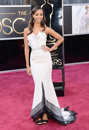 Zoe Saldana showed her elegant red carpet style at the 2013 Oscars in this gray crepe bustier gown with a belted waist and feminine floral applique neckline.