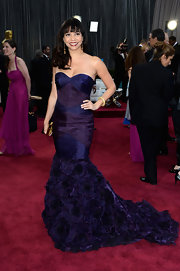 Gloria Reuben rocked a purple silk organza mermaid gown featuring rosette cut-outs on the skirt and a hand-draped bodice at the 2013 Oscars.