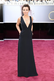 Samantha Barks showed off her svelte figure in a black gown with a deep neckline at the 2013 Oscars red carpet.