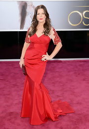 Marcia Gay Harden matched the red of the Oscars' carpet in a ruby red silk gown with a sweetheart neckline and beaded sleeves.