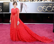 Sally Field is no stranger to the Oscars. The star showed her timeless and classic style in this long-sleeve red gown with a ruched train.