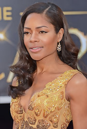Naomie Harris topped off her Oscar look with yellow gold and clear quartz earrings.