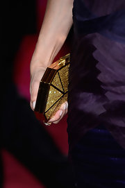 Gloria Reuben kept her 2013 Oscar look classic and sophisticated with this gold clutch with canary yellow crystals.