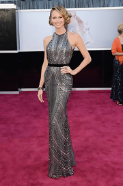 Stay Keibler showed some retro-inspired glamour at the Oscars with this silver art-deco style dress with black belt.