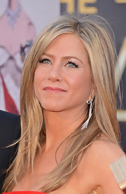 Jennifer Aniston sparkled in diamonds at the 2013 Oscars with a pair of diamond and platinum fringed chandelier earrings.