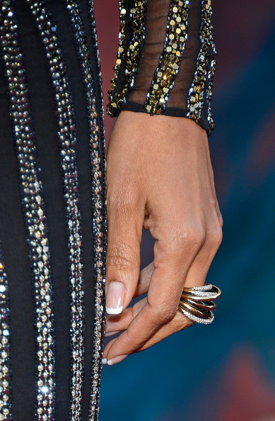 Halle Berry kept her look modern and cool at the 2013 Oscars with this gladiator style diamond ring.