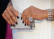 Queen Latifah was all about the bling on the Oscar's red carpet, especially with this white gold and diamond ring.