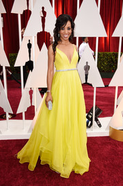 Shaun Robinson was a sun-kissed princess at the Oscars in a yellow Leanne Marshall gown with a deep-V neckline, a bedazzled belt, and a full, layered skirt.