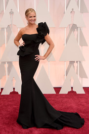 Nancy O'Dell looked statuesque and sophisticated at the Oscars in a black Gauri & Nainika one-shoulder gown with a long train and ultra-feminine ruffle detailing.