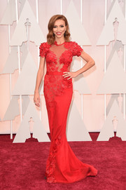 Giuliana Rancic was an Old Hollywood beauty at the Oscars in a flower-appliqued, sheer-panel red gown by Mireille Dagher.