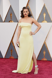 Andra Day went for minimalist elegance in a yellow off-one-shoulder gown by SAFiYAA at the Oscars.
