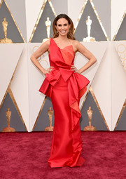 Keltie Knight donned an architectural red and orange strapless gown by Lucian Matis for the Oscars.