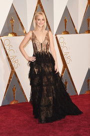 Jennifer Lawrence got all dolled up in a frilly black lace gown by Dior Haute Couture for the Oscars.