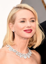 Naomi Watts complemented her strapless dress with a stunning diamond collar necklace by Bulgari.