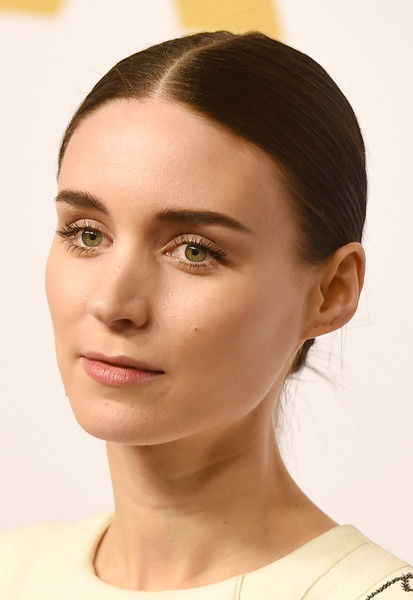 Rooney Mara stuck to her usual slicked-down bun when she attended the Academy Awards nominee luncheon.