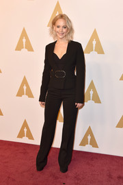 Jennifer Lawrence was '70s-chic in this black Stella McCartney pantsuit while attending the Academy Awards nominee luncheon.