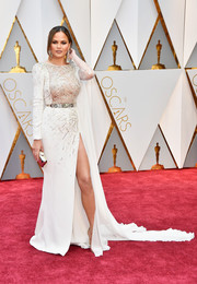 Chrissy Teigen was her usual seductive self in an embellished ivory Zuhair Murad Couture gown with a hip-high slit during the 2017 Oscars.