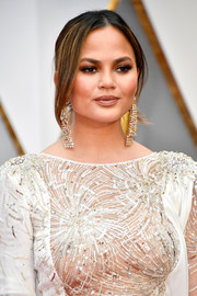 Chrissy Teigen complemented her bedazzled dress with a pair of diamond chandelier earrings by Lorraine Schwartz.