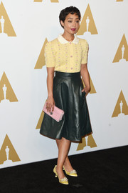 A pair of embellished satin pumps (also by Miu Miu) pulled Ruth Negga's look together.