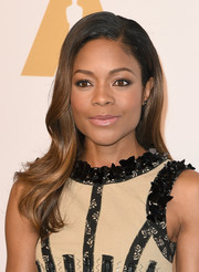 Naomie Harris sported a sweet wavy hairstyle at the Academy Awards nominees luncheon.