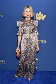 Naomi Watts kept it sweet and ladylike in a floral gown with smocked sleeves and a flared hem at the 2019 Australians in Film Awards Gala.
