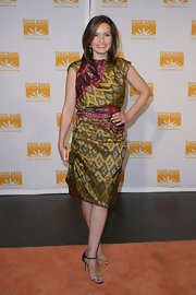 Mariska wears a print cocktail dress with an Indian textile influence.