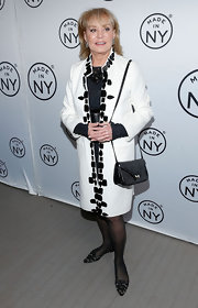 Barbara Walters kept her look classic and sophisticated with a white coat that featured black geometric embellishments.