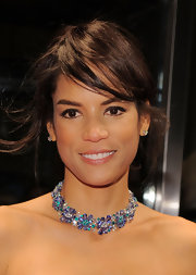 Veronica Webb adorned her bare neckline with a sparkling collar necklace full of multi-colored gemstones.
