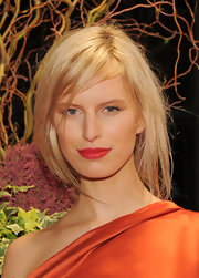 Karolina Kurkova added a bight touch to her natural look with matte red lipstick.