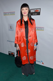 Bronagh Gallagher opted for a classic Asian-inspired evening coat for her evening look while attending a pre-Oscar event.