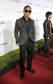 Romeo Miller wore a sharp gray blazer with black trim to the 8h Annual Teen Vogue party.