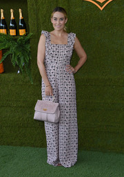 Lauren Conrad complemented her jumpsuit with a pale pink single-strap tote, also from her line.