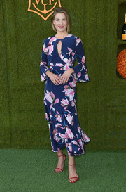 Ali Larter's red skinny-strap sandals worked beautifully with her blue floral dress.