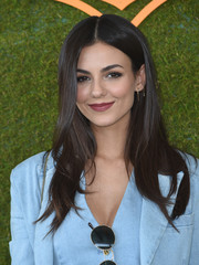 Victoria Justice wore her long hair down in a simple center-parted style at the Veuve Clicquot Polo Classic.