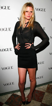 Lara paired her black bandage skirt with a chain layered necklace.