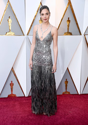Gal Gadot brought a heavy dose of sparkle to the 2018 Oscars red carpet with this fringed silver gown by Givenchy Couture.