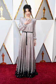 Sally Hawkins glittered in a micro-beaded gold Armani Prive gown with a contrast belt and hem at the 2018 Oscars.