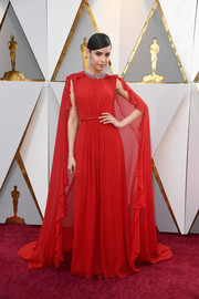 Sofia Carson made a breathtaking entrance in a caped red ruffle gown by Giambattista Valli at the 2018 Oscars.