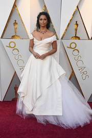 Camila Alves looked exquisite in an ivory Vivienne Westwood off-the-shoulder gown with a voluminous tulle underskirt at the 2018 Oscars.