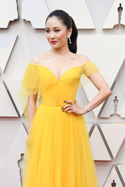 Constance Wu blinged up with an Atelier Swarovski diamond bracelet and matching earrings at the 2019 Oscars.