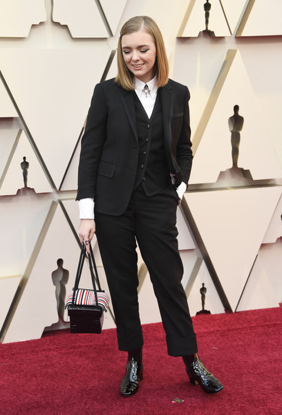 More Pics of Elsie Fisher Leather Purse (1 of 10) - Elsie Fisher Lookbook - StyleBistro [red carpet,carpet,suit,flooring,pantsuit,formal wear,fashion,tuxedo,footwear,outerwear,arrivals,elsie fisher,academy awards,hollywood,highland,california,annual academy awards]