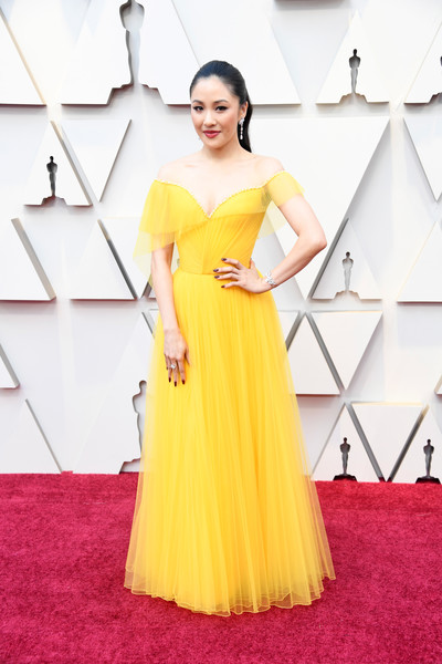 More Pics of Constance Wu Diamond Bracelet (2 of 12) - Bracelets Lookbook - StyleBistro [dress,clothing,red carpet,yellow,shoulder,gown,carpet,fashion model,flooring,a-line,arrivals,constance wu,academy awards,hollywood,highland,california,annual academy awards]
