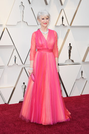Helen Mirren looked breathtaking in a pink wrap gown by Schiaparelli Couture at the 2019 Oscars.