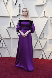Lucy Boynton looked romantic in a purple off-the-shoulder gown by Rodarte at the 2019 Oscars.