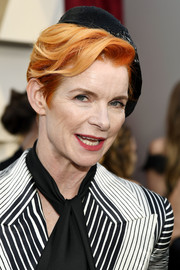 Sandy Powell attended the 2019 Oscars wearing a short, side-parted 'do under a lopsided beret.