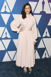 Rachel Weisz kept it modest in a pale pink ruffle-neck gown by Marc Jacobs at the Oscar nominees luncheon.