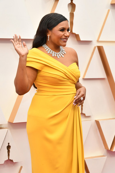 More Pics of Mindy Kaling Dangling Diamond Earrings (1 of 9) - Dangling Diamond Earrings Lookbook - StyleBistro [yellow,clothing,shoulder,dress,fashion,formal wear,fashion design,photo shoot,flooring,neck,arrivals,mindy kaling,hollywood,highland,california,92nd annual academy awards,mindy kaling,hollywood highland,academy awards,advancing women,model,livingly media,academy award for best picture,2020,fashion,face tat]