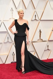 Charlize Theron kept it simple yet glam in a black off-one-shoulder gown by Dior Couture at the 2020 Oscars.