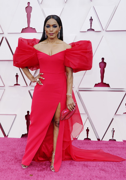 Angela Bassett cut a dramatic silhouette in an off-the-shoulder red Alberta Ferretti gown with puffed sleeves and a high slit at the 2021 Oscars.